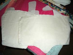 The padded interlining basted to muslin.