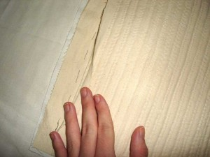 Cutting away the batting seam allowance, the twill soon to follow.