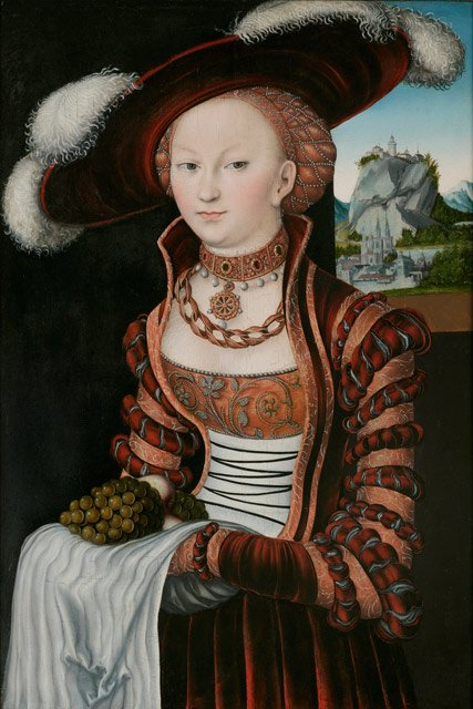 Cranach the Elder 1528, portrait of a young woman holding grapes and apples.
