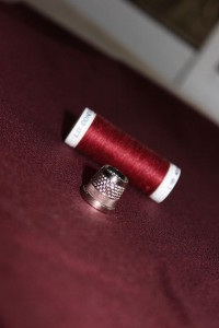wine red wool and thread