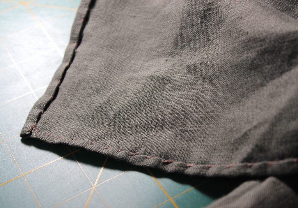 Hand sewn linen apron hem