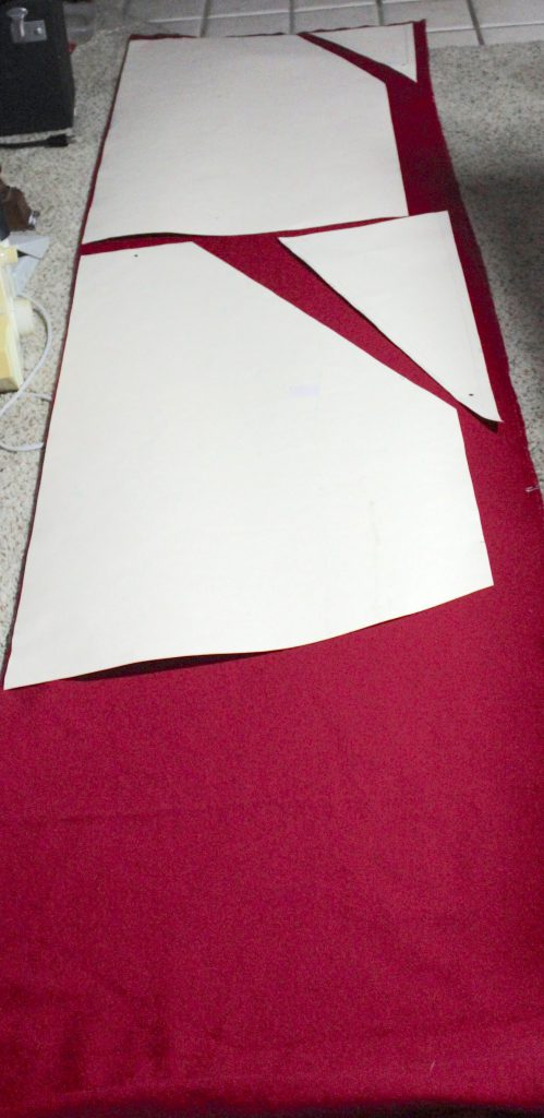 Petticoat skirt pattern laid out on the red wool fabric