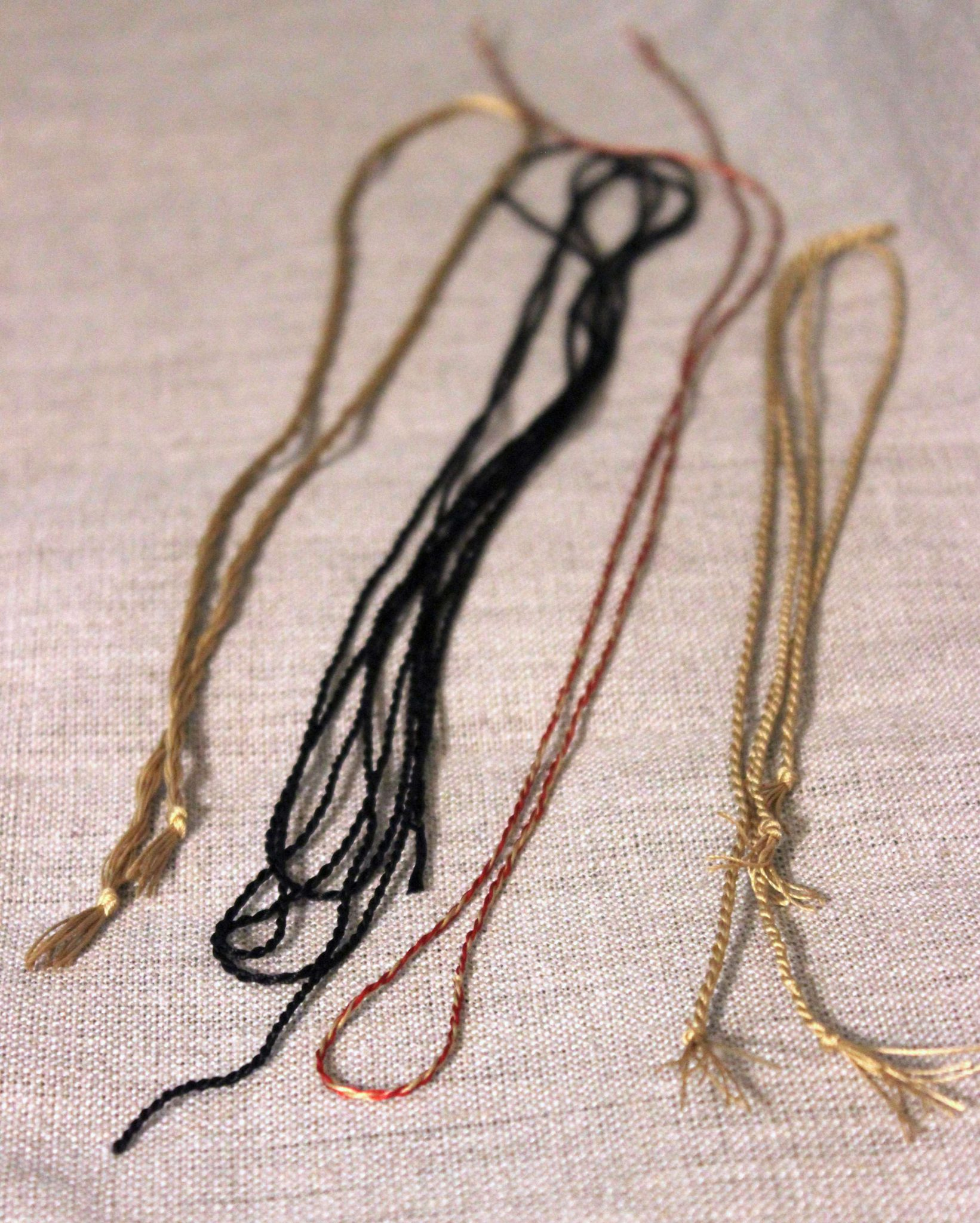 Gold black and red silk cords