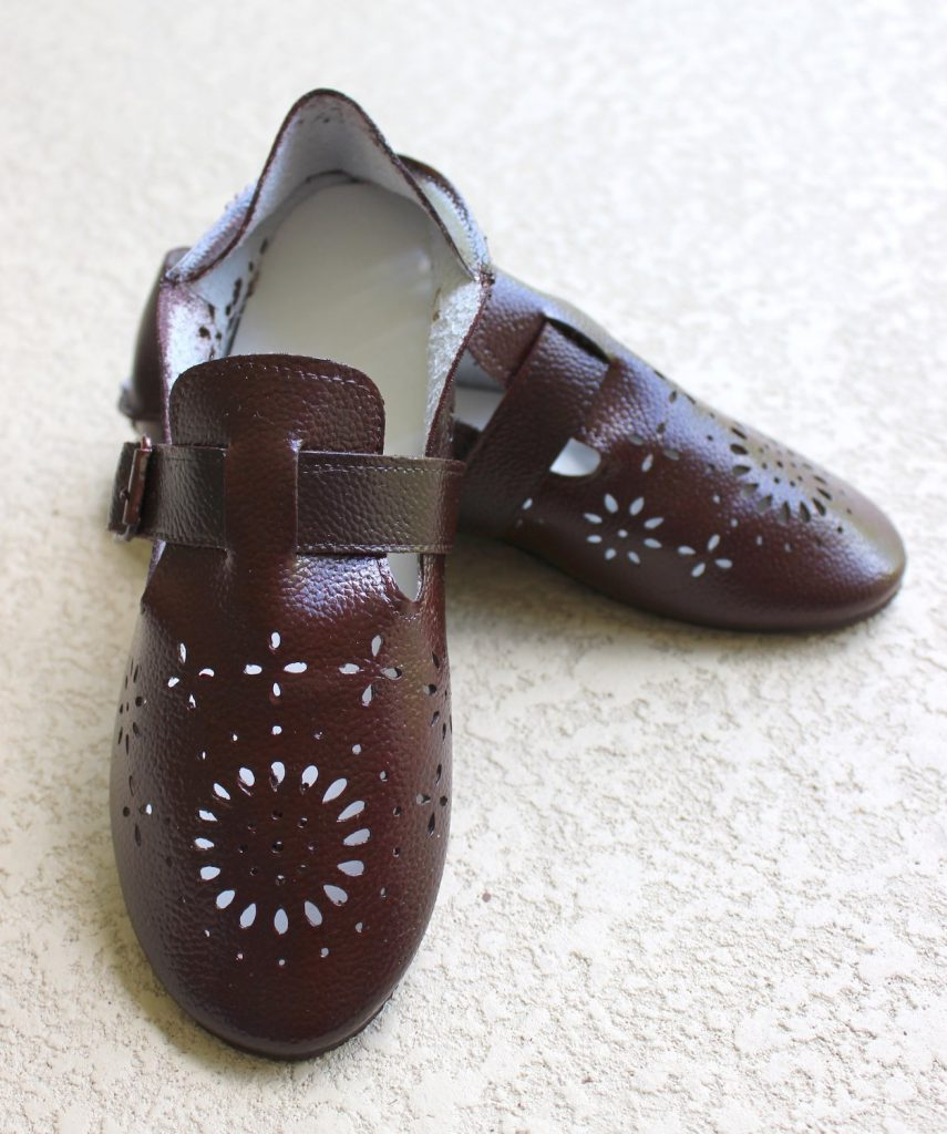 Painted shoes in an oxblood color