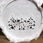 Cutwork lace white cotton thread on white linen
