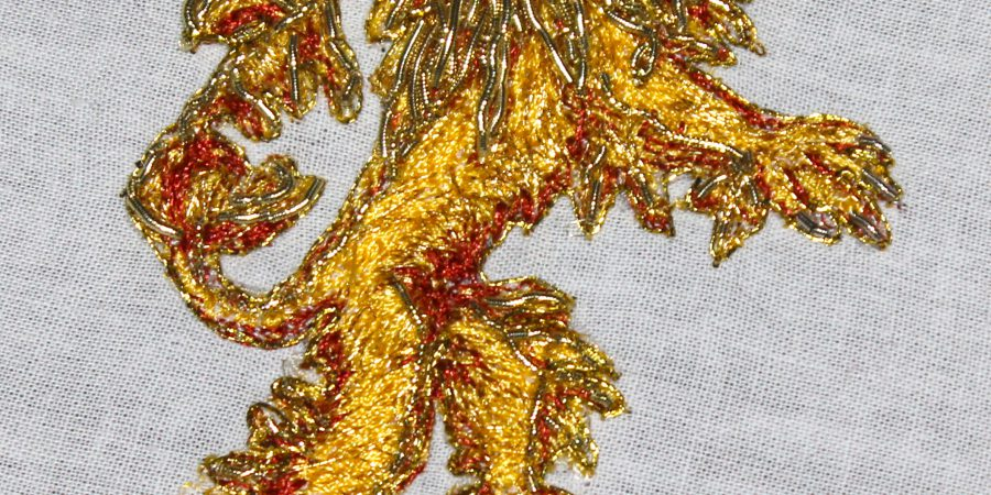 Lannister Embroidery a gold lion worked in yellow thread with gold bullion mane and tail