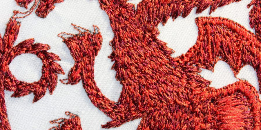 Targaryen Embroidery a red three headed dragon on a white cotton background