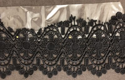 Wash away stabilizer pinned in place to the black lace